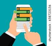 hand holding white mobile phone ...   Shutterstock .eps vector #658723156