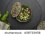Small photo of salad with veal and in dark bread on dark background