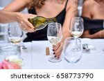 woman pouring wine into a glass | Shutterstock . vector #658773790