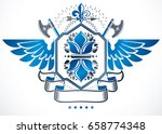 winged heraldic sign made with... | Shutterstock .eps vector #658774348