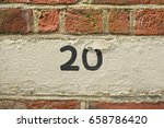 house number 20 sign painted on ... | Shutterstock . vector #658786420
