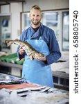 Small photo of Fishmonger selling fish