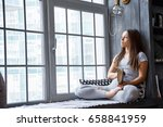 woman reading book at home in... | Shutterstock . vector #658841959
