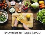 hands using a knife chopping... | Shutterstock . vector #658843930