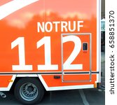 Small photo of gerrman ambulance car rettungswagen and phone number