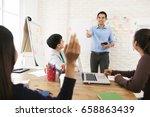 asian male teacher asking... | Shutterstock . vector #658863439