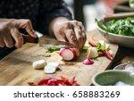 hands using a knife chopping... | Shutterstock . vector #658883269