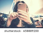girl at fair with smartphone ... | Shutterstock . vector #658889200
