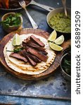 grilled skirt steak fajitas... | Shutterstock . vector #658892509