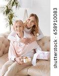daughter embracing mother... | Shutterstock . vector #658910083