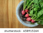 red radish with green leaves in ... | Shutterstock . vector #658915264