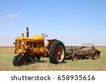 Old Yellow Tractor In Field