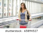 Young woman shopping at supermarket - stock photo