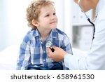 doctor examining a child ...   Shutterstock . vector #658961530