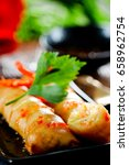 fried chinese spring rolls with ... | Shutterstock . vector #658962754