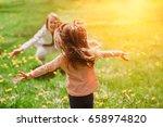 child running into mother's... | Shutterstock . vector #658974820