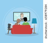 watching tv at home. | Shutterstock . vector #658979284