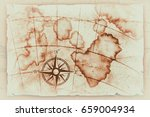 old map with a compass on it  | Shutterstock . vector #659004934