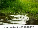 rain falling in the puddle and... | Shutterstock . vector #659010196