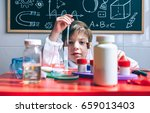 kid playing with chemical... | Shutterstock . vector #659013403