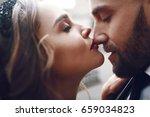 woman kisses man's nose tender   Shutterstock . vector #659034823