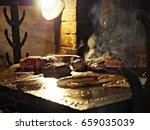 meat steaks on the grill | Shutterstock . vector #659035039