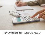 people calculate about cost at... | Shutterstock . vector #659037610