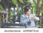 woman using mobile payments