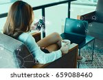 woman using mobile payments... | Shutterstock . vector #659088460
