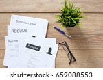 resume applications on wooden... | Shutterstock . vector #659088553