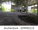 Small photo of Abandoned unworthy, from the biton hangar inside, among the day