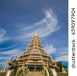 Small photo of wat hyua pla kang temple and Goddess of Mercy at Chiang Rai, Asia Thailand, public domain or treasure of Buddhism mountain