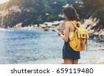 hipster girl with backpack hold ... | Shutterstock . vector #659119480