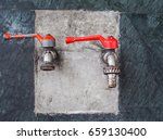 old faucets are mounted on the... | Shutterstock . vector #659130400