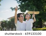 asian father and son playing... | Shutterstock . vector #659133100
