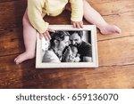 unrecognizable baby holding... | Shutterstock . vector #659136070