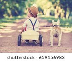 little boy and cute dog playing ... | Shutterstock . vector #659156983