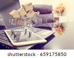 small boxes in a shopping cart... | Shutterstock . vector #659175850