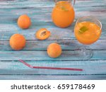 fresh apricot juice in a glass... | Shutterstock . vector #659178469