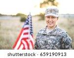 happy female soldier in desert... | Shutterstock . vector #659190913