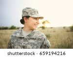 Female Soldier Smiles In The...