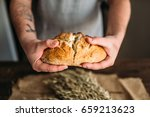 baker hands breaks in half... | Shutterstock . vector #659213623