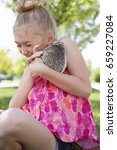 a young girl holding a hedgehog ... | Shutterstock . vector #659227084