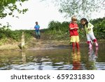 children in rainboots playing... | Shutterstock . vector #659231830