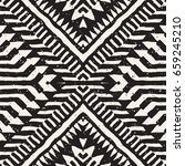 Black and white tribal vector seamless pattern with doodle elements. Aztec abstract geometric art print. Ethnic ornamental hand drawn backdrop. | Shutterstock vector #659245210