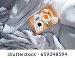 breakfast in bed  a tray of... | Shutterstock . vector #659248594
