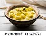 Small photo of Angoori rasmalai or anguri ras malai is an Indian dessert. Made from cottage cheese which is then soaked in chashni, a sugary syrup, and rolled in fine sugar to form grape-sized balls. selective focus