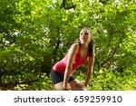 jogger resting in forest   Shutterstock . vector #659259910