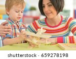 young mother playing with son | Shutterstock . vector #659278198