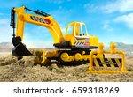 excavator toy closeup....   Shutterstock . vector #659318269